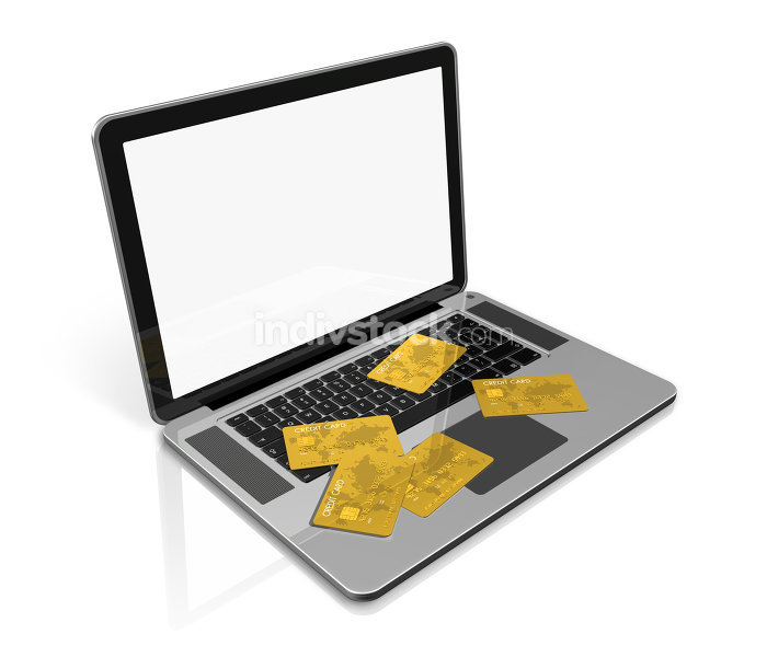 gold credit cards on laptop