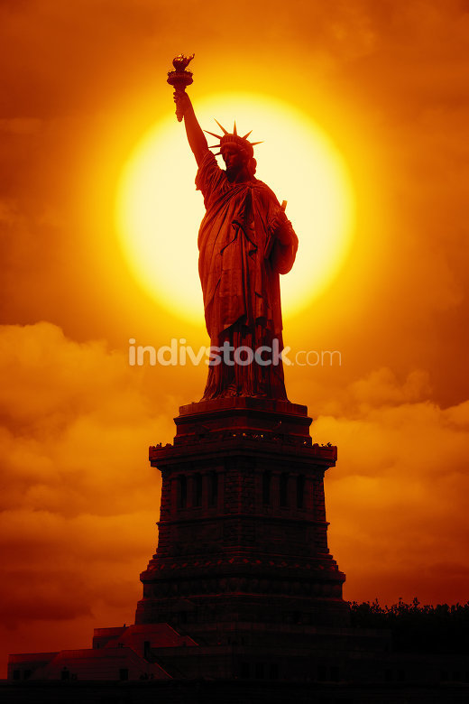liberty statue at sunset