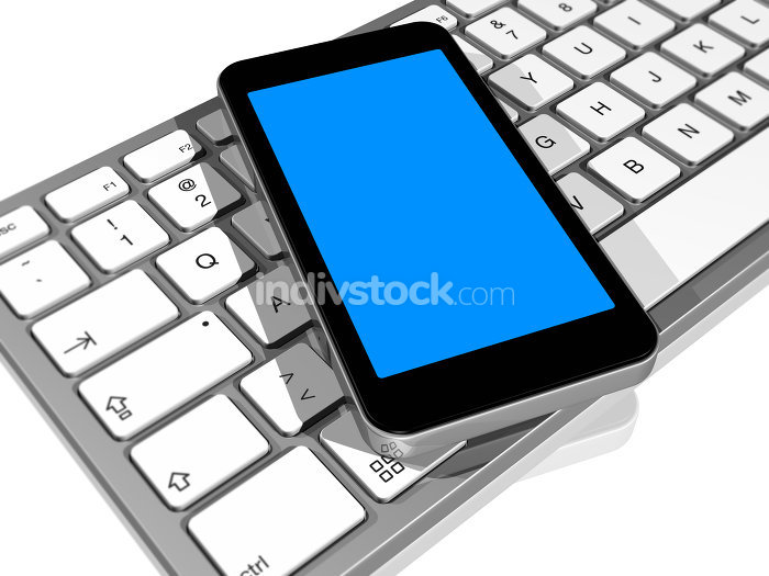 mobile phone on a computer keyboard