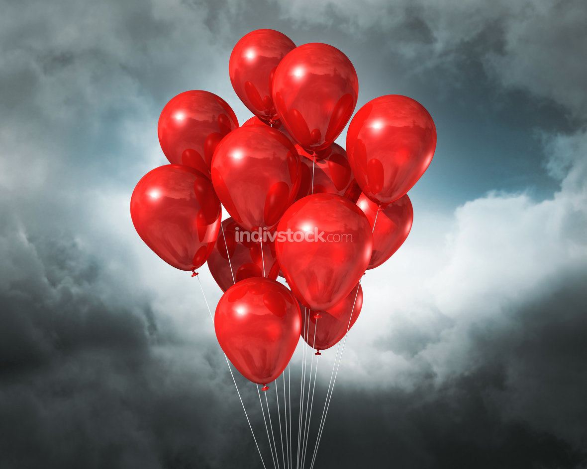 red balloons on a cloudy dramatic sky