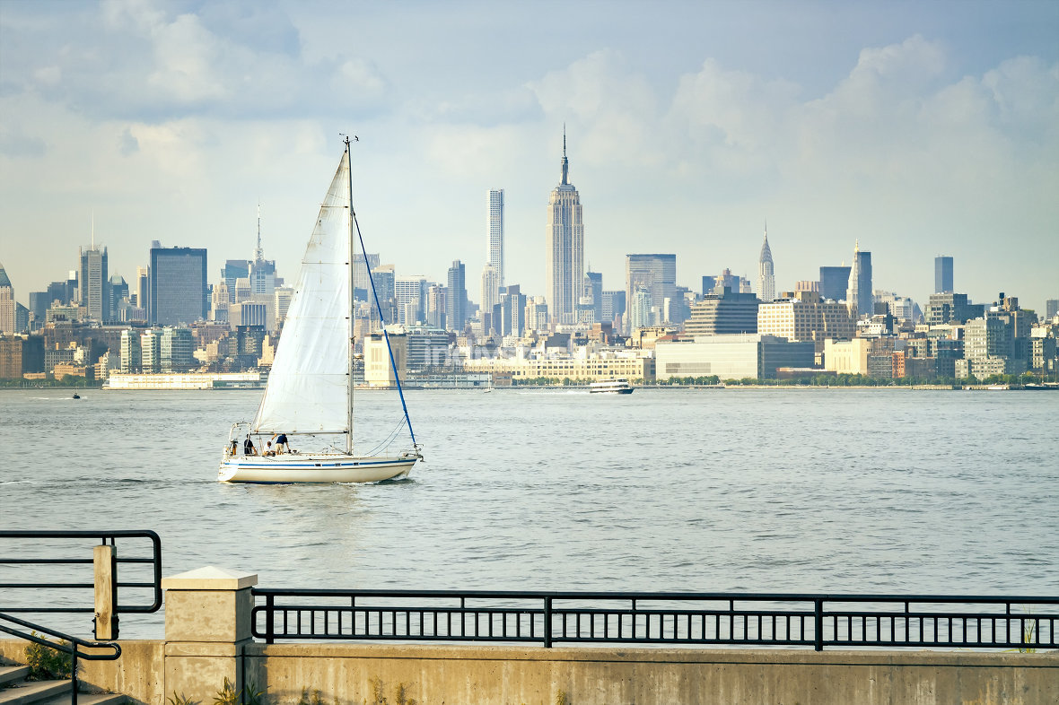 sailing boat in front of New York Manhattan