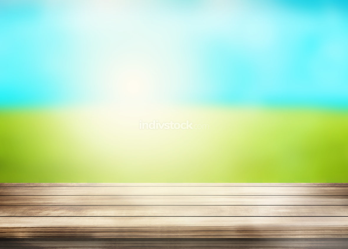 wood desk sunny outdoor green grass blue sky