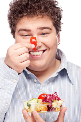 chubby man with fresh salad