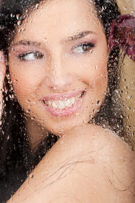 woman behind wet glass