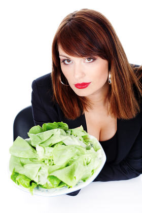 woman offering green salad