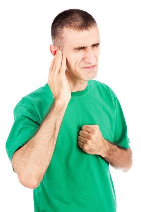 Man feeling pain in ear