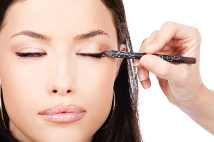 applying cosmetic pencil on eye