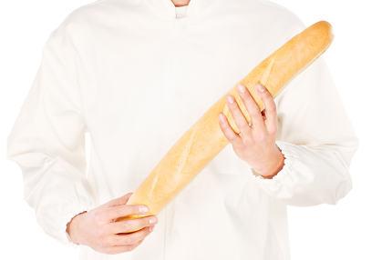 baguette in a hands of a backer