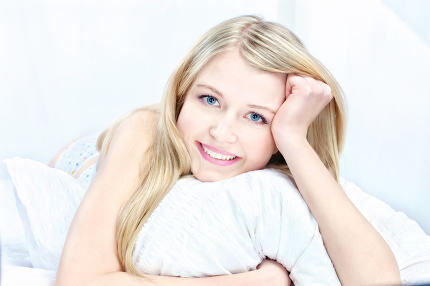 blond woman on pillow
