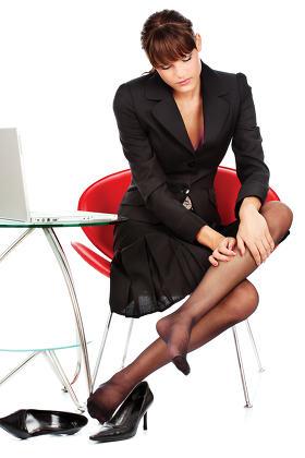business woman make leg massage