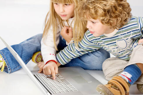 Children turning on computer