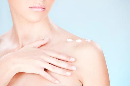 cosmetic cream on woman