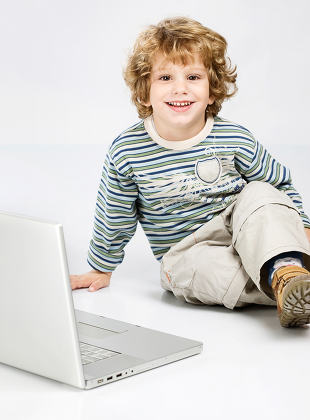 curl hair boy near laptop