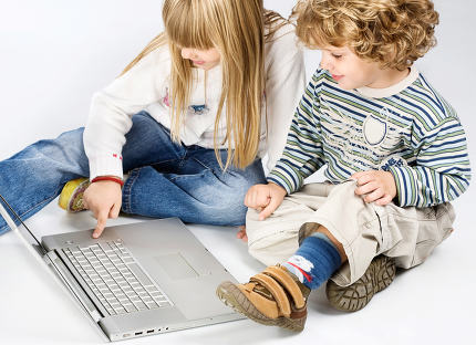 girl and boy near laptop