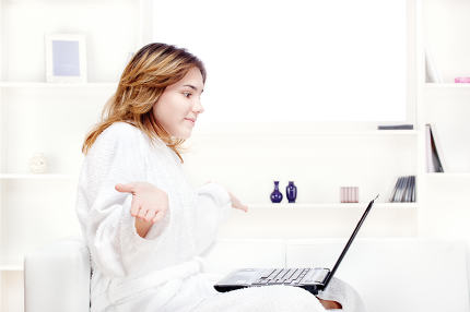 girl in bathrobe chatting on computer