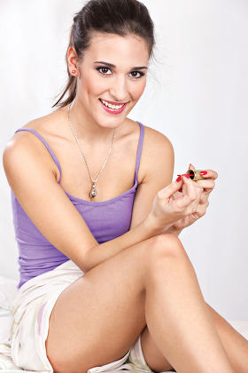 girl in bed girl applying nail polish