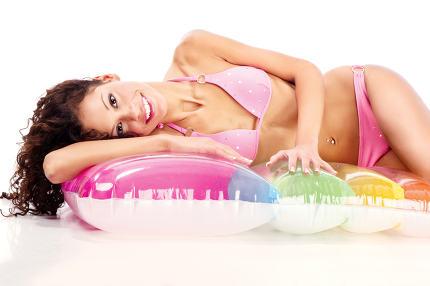 girl in bikini on air mattress
