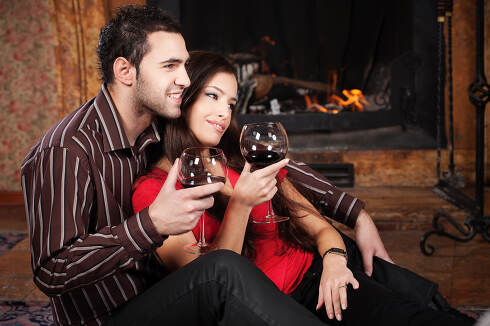 Happy couple near fireplace