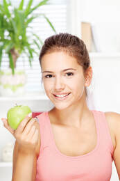 happy woman at home with fruit