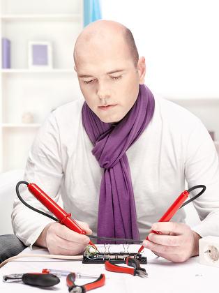 man doing minor repair at home