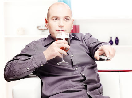 man relaxing at home with beer