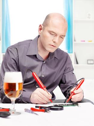 man repairing an electronic device