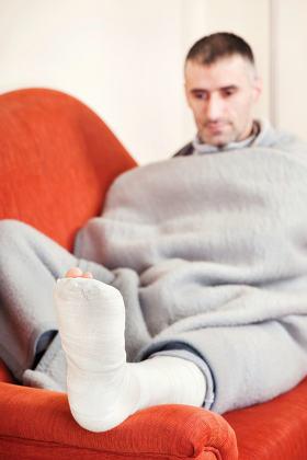 man with broken leg