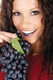 pretty girl eating grape