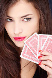 Pretty woman holding gambling cards
