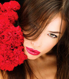 woman and bouquet of red carnations