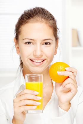 Woman and fresh orange juice