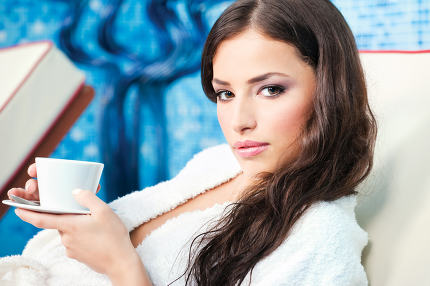 Woman enjoy cup of coffee in spa center