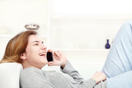 woman have joyful talk over phone