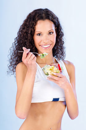 woman have salad on fork