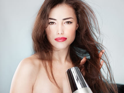 woman holding blow dryer