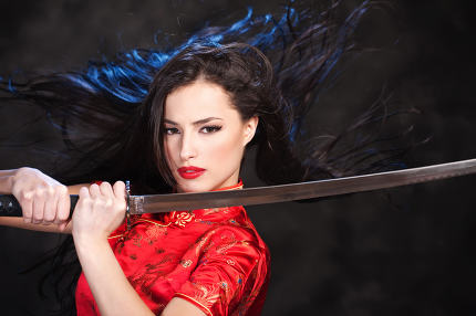 woman in action hold katana