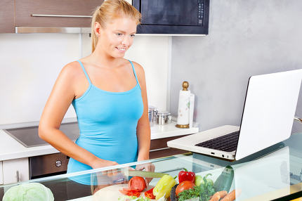 woman in kitchen with laptop