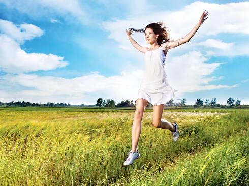 woman running across field