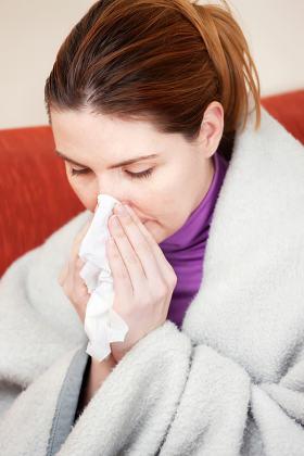 woman sneezing in the handkerchief