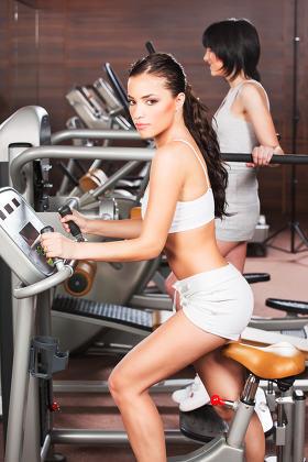 Women exercise in gym center