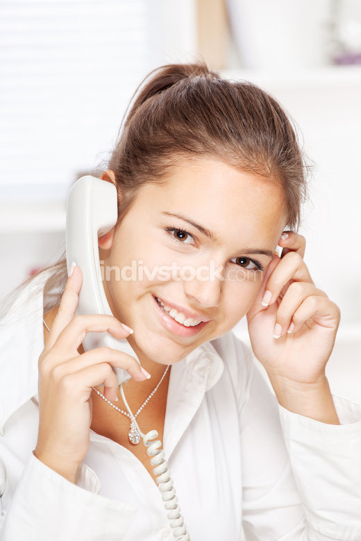 Woman on land line call