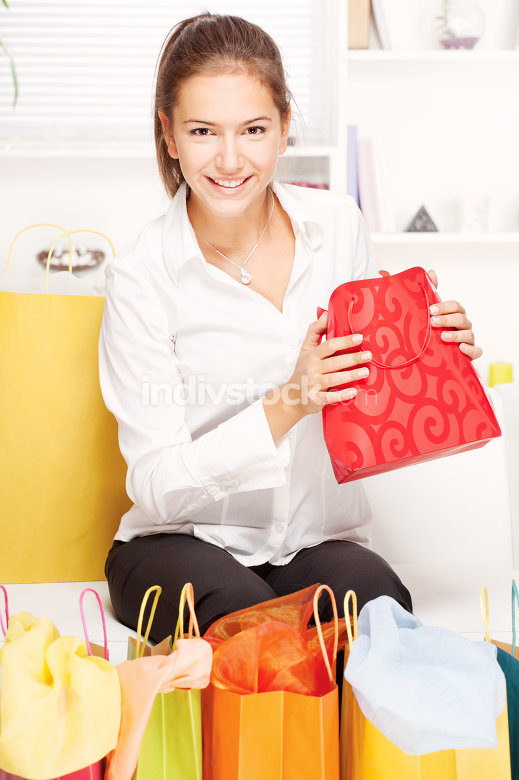 woman on sofa with shopping bags