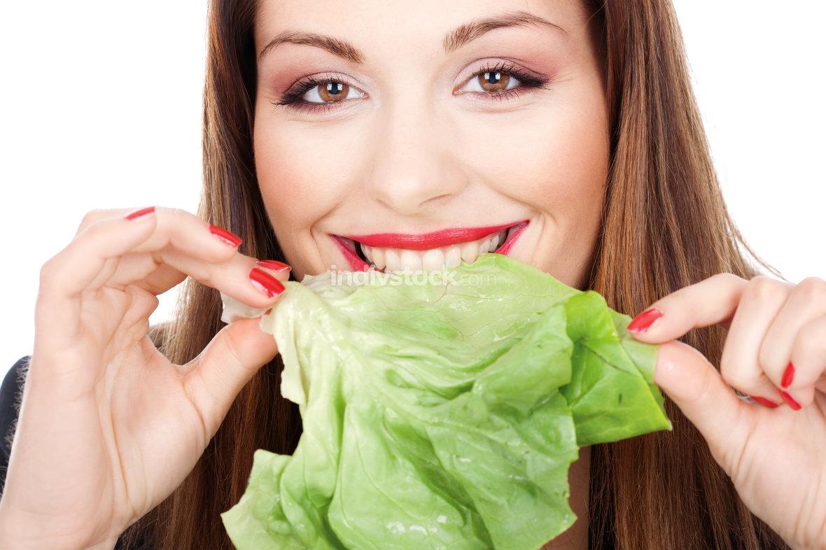 Woman eating green salad