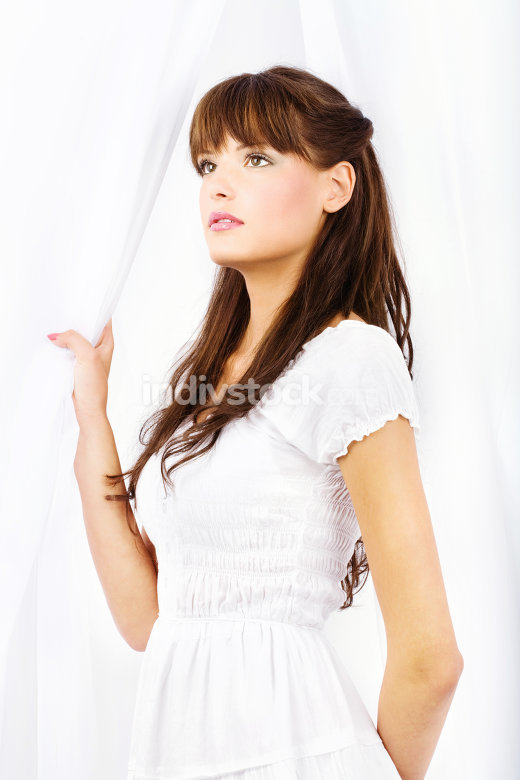 brunette near white curtain