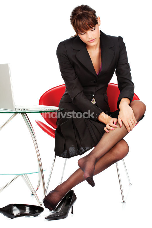 business woman make leg massage