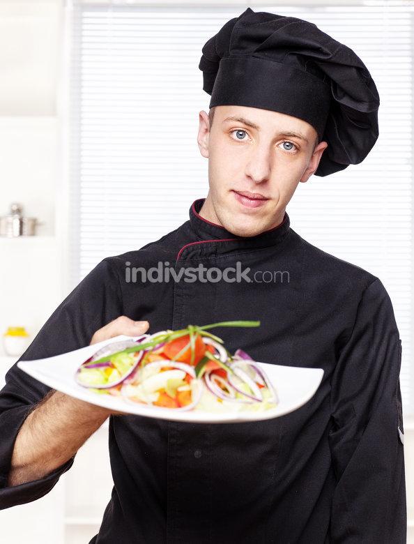 chef in black uniform offer salad