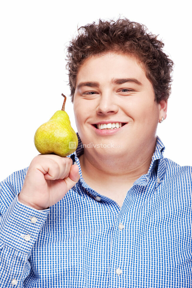 Chubby boy and pear
