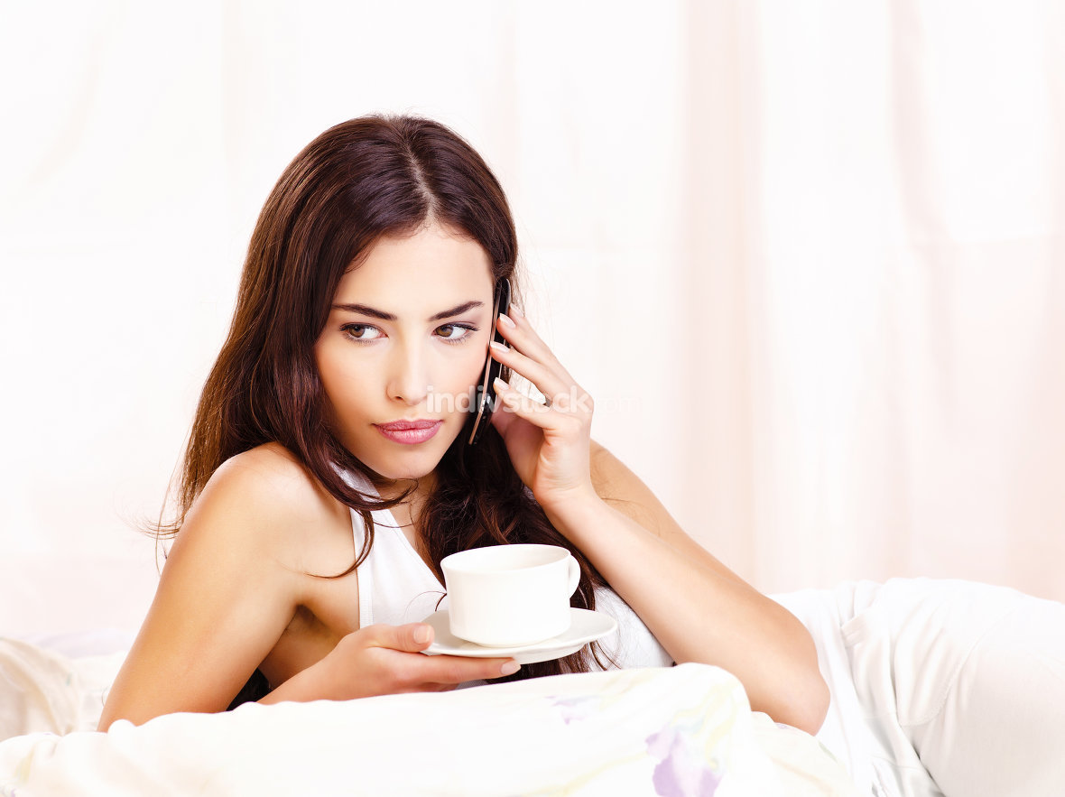 coffee and phone in bed