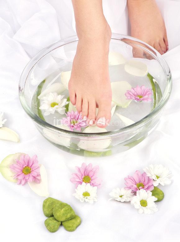 Feet in aromatherapy bowl