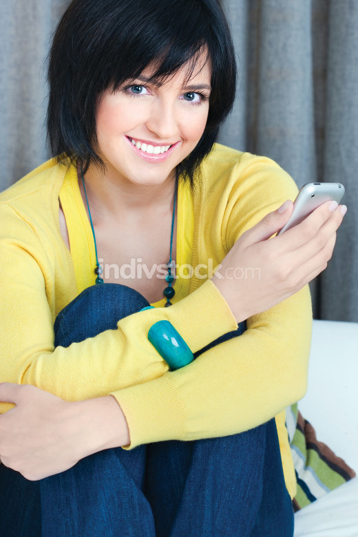 girl using mobile phone at home